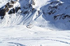 Alpine hut Potsdamer Hutte and mountain panorama with snow in winter in Stubai Alps Royalty Free Stock Photography