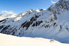 Alpine hut Potsdamer Hutte and mountain panorama with snow in winter in Stubai Alps Stock Photo