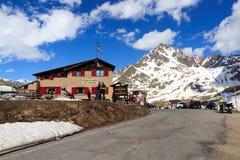 Alpine hut Rifugio Bonetta at gavia pass and mountain Corno dei Tre Signori Stock Photo