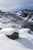 Alpine hut under snow Royalty Free Stock Images