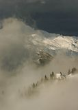 Alpine hut view. Alpine cottages with trees in bacgroung mountain peak Royalty Free Stock Photography