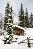 Alpine hut in winter in the Alps. Winter Landscape in a Forest near Lake Antholz Anterselva, South Tirol. Stock Photos