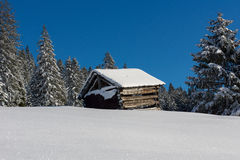 Alpine hut in the winter Stock Photos