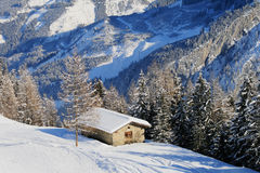 Alpine hut in winter. Roof covered with a layer of snow Royalty Free Stock Photography