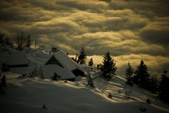 Alpine huts. Alpine hut in alps in middle of snowy chrismas pines in winter Stock Photo