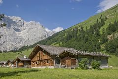 Alpine huts in the Eng in Tyrol. Idyllic huts on the alpine pastures of Eng in the heart of the Karwendel mountains in Tirol royalty free stock image