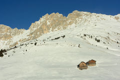 Alpine huts on snowy mountain Royalty Free Stock Images