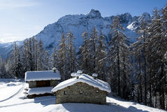 Alpine huts under snow Royalty Free Stock Photography