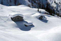 Alpine huts under snow Royalty Free Stock Image