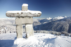 Alpine Inunnguac. A structure similar to an inuksuk but meant to represent a human figure, called an inunnguaq is a traditional native sculpture. This is also Stock Photos