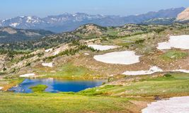Alpine lake along the Beartooth Highway. Yellowstone Park, Peaks of Beartooth Mountains, Shoshone National Forest, Wyoming, USA. Alpine lake along the Beartooth royalty free stock photo