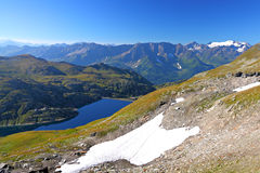 Alpine lake amidst high mountains Royalty Free Stock Image