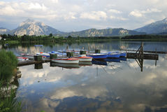Alpine lake with boats. Boats in Lake Hopfsee in the Allgäu (Bavaria, Germany Stock Images