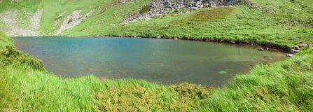 Alpine lake Brebeneckul on mountains (panorama) Royalty Free Stock Photos