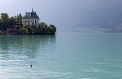 Iseltwald. Alpine lake Brienz of Jungfrau region, viewed from Iseltwald in Switzerland Royalty Free Stock Image