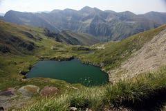 Alpine lake. Capra Lake in Fagaras Mountains, Romania royalty free stock photos