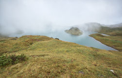 Alpine lake in dense autumn fog. Germany Royalty Free Stock Images