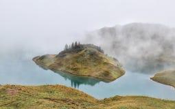 Alpine lake in dense fog Royalty Free Stock Photos