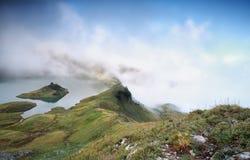 Alpine lake in dense fog Stock Photo