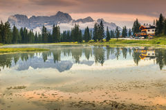 Alpine lake in Dolomites and Sorapis mountain group,Lago di Antorno. Majestic sunset in the Dolomites.Lago di Antorno,Italy royalty free stock image