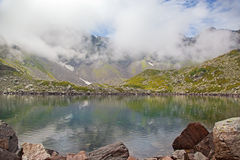 Alpine lake in the fog. Stock Photo