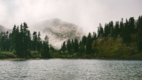 Alpine lake in fog Royalty Free Stock Photography