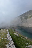Alpine lake with fog, Maritime Alps, Italy. Alpine lake in the Italian nature reserve of Parco delle Alpi Marittime, Piemonte - Piedmont - Italy. Lago di Stock Images