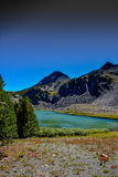 Alpine Lake. Green, alpine lake in California. Picture taken in the fall. Green shrubs around the bank Stock Image