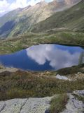Alpine lake with mirror effect stock image