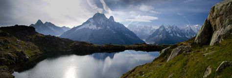 Alpine lake and mountains stock photography