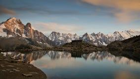 Alpine lake and mountains stock photos