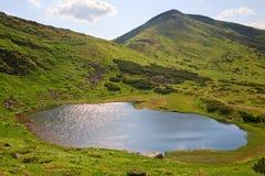 Alpine lake Nesamovyte on summer mountains Stock Photos