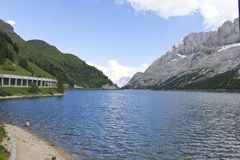 Alpine lake. Overview of Lake Fedaia with Marmolada mountain, in Italy Royalty Free Stock Photography