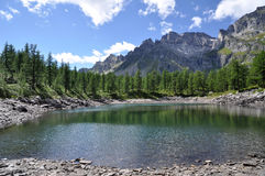 Alpine lake panorama. A view of Lago Nero, small alpine lake, Devero Park, Italy Royalty Free Stock Photos