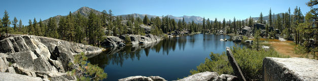 Alpine Lake Panorama in the Sierra Nevada's. A pristine alpine lake in the western Sierra Nevada Mountains of California Royalty Free Stock Images