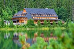 Popradske Pleso mountain lake in High Tatras mountain range in Slovakia. Alpine lake Popradske pleso with touristic shelter - Chata pri popradskom plese royalty free stock image