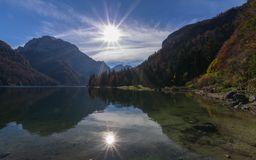 Alpine lake of Raibl. An image of the lake of Raibl also called lake of Predil on the Alps of Friuli with the sunshine that is reflected on the surface of the Royalty Free Stock Photos