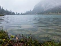 Alpine lake on a rainy day royalty free stock photography
