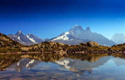 Alpine lake reflection in the French Alps. In the Mont Blanc Massif Royalty Free Stock Photos