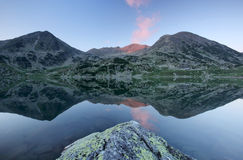 Alpine lake reflection - Retezat Mountain, Romania Royalty Free Stock Photo
