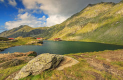 Alpine lake and restaurant on a lake,Balea lake,Fagaras mountains,Carpathians,Romania Stock Photography