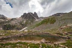 Alpine lake among the rocks Stock Photos