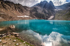 Alpine lake among the rocks Stock Photos