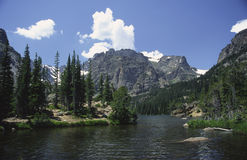 Alpine lake in Rocky Mountains Stock Images