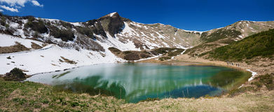 Alpine lake schlappoldsee in mountainous landscape, allgau germany Stock Photos