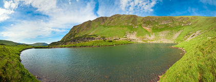 Alpine lake on summer mountains (panorama) Royalty Free Stock Photo