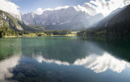 Alpine lake,Sunrise over the alpine lake Laghi di Fusine Stock Images