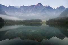 Alpine lake,Sunrise over the alpine lake Laghi di Fusine Royalty Free Stock Photography