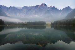 Alpine lake,Sunrise over the alpine lake Laghi di Fusine Royalty Free Stock Photography
