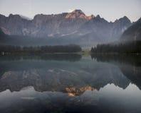 Alpine lake,Sunrise over the alpine lake Laghi di Fusine Royalty Free Stock Image
